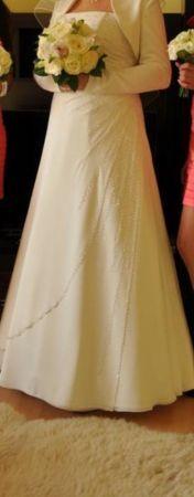 Cena : 1000 PLN. Rozmiar : 40/42. Suknia ślubna  Martika Firmy Karina. Opis :Stan zewnętrzny bardzo dobry, suknia wyczyszczona. Kolor śmietankowy, zdobiona kryształkami ręcznie wyszywanymi, sznurowana. Mogę podesłać na maila więcej zdjęć.