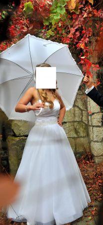 Cena : 1100 PLN. Rozmiar : 38. Suknia ślubna  Sue Firmy Igar. Opis :Mam na sprzedaż śnieżnobiałą suknię ślubną