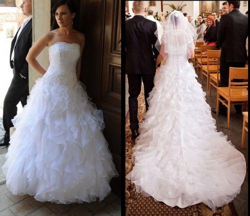 Cena : 1000 PLN. Rozmiar : 36,38. Suknia ślubna   Firmy . Opis :Sprzedam jednoczęściową białą suknię ślubną ze zwiewnych falban. Wygodna i lekka o zdobionym gorsecie z podpinanym trenem. Dobrze dopasowuje się do sylwetki. Sukienka dzięki wiązanemu gorsetowi jest regulowana w biodrach i na plecach.