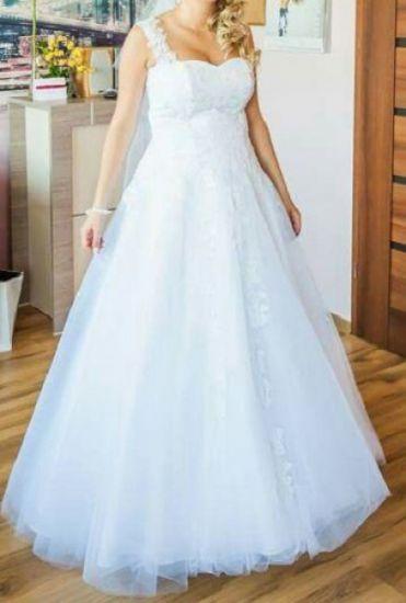 Cena : 1200 PLN. Rozmiar : 40,42,44. Suknia ślubna   Firmy . Opis :opis