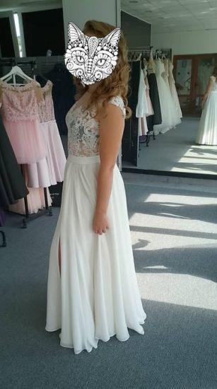 Cena : 1150 PLN. Rozmiar : 36,38. Suknia ślubna  Suknia ślubna Firmy Dimira. Opis :nowoczesna suknia ślubna używana tylko raz w idealnym stanie