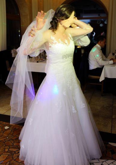 Cena : 2250 PLN. Rozmiar : 38,40. Suknia ślubna  Madonna Firmy Princessa. Opis :Suknia Ślubna Princessa z salonu Madonny
