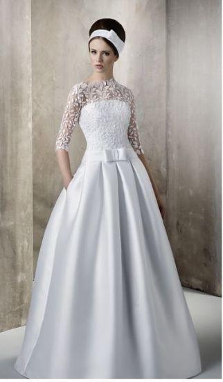 Cena : 990 PLN. Rozmiar : 36,38. Suknia ślubna  Suknia ślubna Z Kieszeniami Firmy 1987. Opis :Witam Mam do sprzedania piękną suknię ślubną z bolerkiem i welonem. Suknia jest unikalna, ponieważ posiada kieszenie. Kolor biały. Rozmiar 36/38. Cena 990 zł, podlega negocjacji. Zapraszam do zakupu.